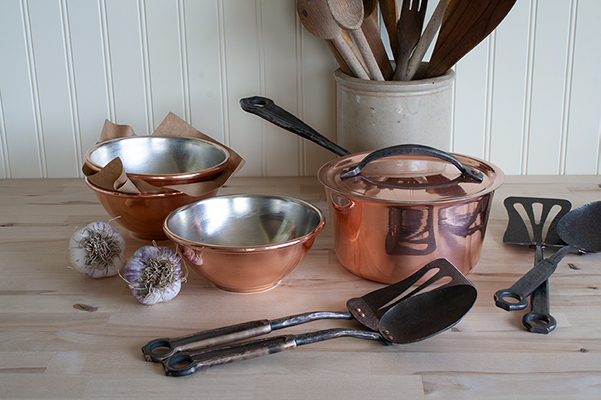 Hand tinned copperware with utensils