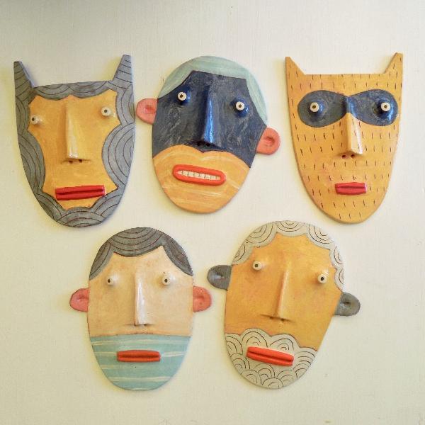 Flat heads -wall sculptures