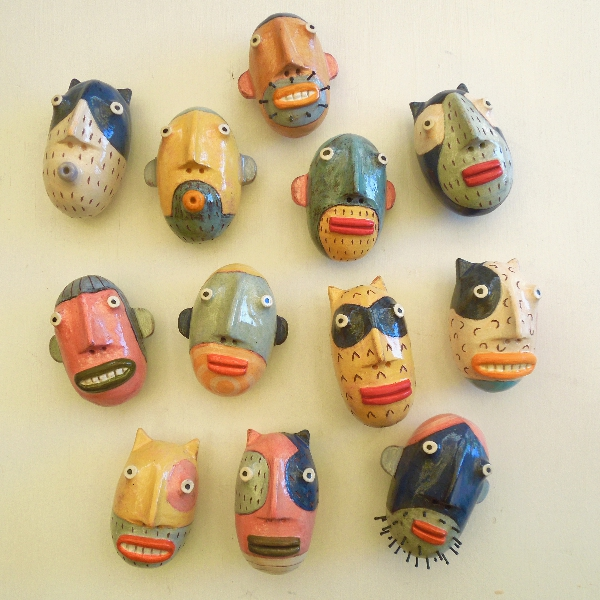 Small Rd Heads- wall sculptures